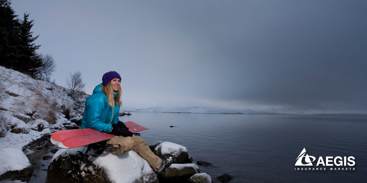 Happy Snowboarder Looking at Lake
